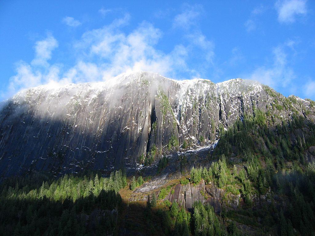 Sprinkles of snow dot precipitous cliffs. Rudyerd Bay area, Southeast Alaska.