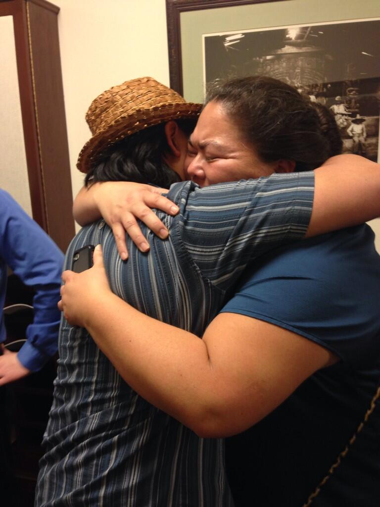 Lance Twitchell and Liz Medicine Crow embrace after HB 216 passed. (Photo by Casey Kelly/KTOO)