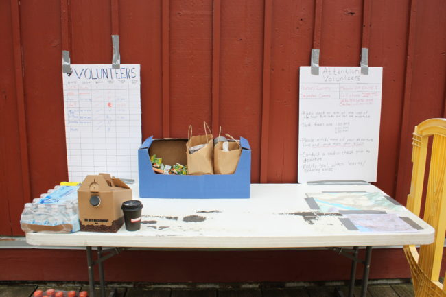 The volunteer search table is located behind the Mt. Roberts Tramway building. Volunteers are needed. The team will meet up Friday, Saturday and Sunday morning at 9 a.m. Volunteers can also contact Luke Holton on Facebook. (Photo by Lisa Phu/KTOO)