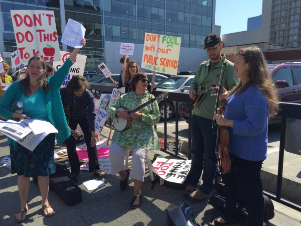 Fiddlers and protesters gather outside the LIO in downtown Anchorage. (Photo by Anne Hillman/KSKA)