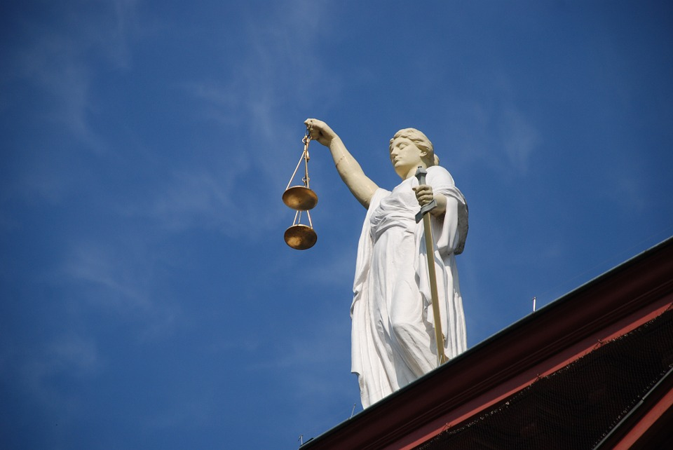 Lady Justice at the U.S. Supreme Courthouse in Washington, D.C. (Public Domain photo)