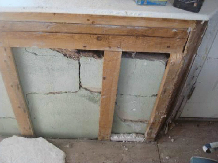 This photo, taken after Superstorm Sandy, shows cracks in the foundation of Doug Quinn's home. The insurance company claimed that the cracks were there before Sandy. Courtesy of Doug Quinn