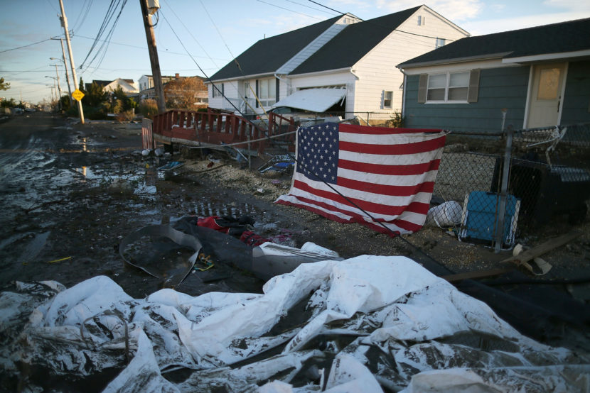 An American flag flies in front of a home damaged by Superstorm Sandy on Nov. 1, 2012, in Toms River, N.J. Mark Wilson/Getty Images