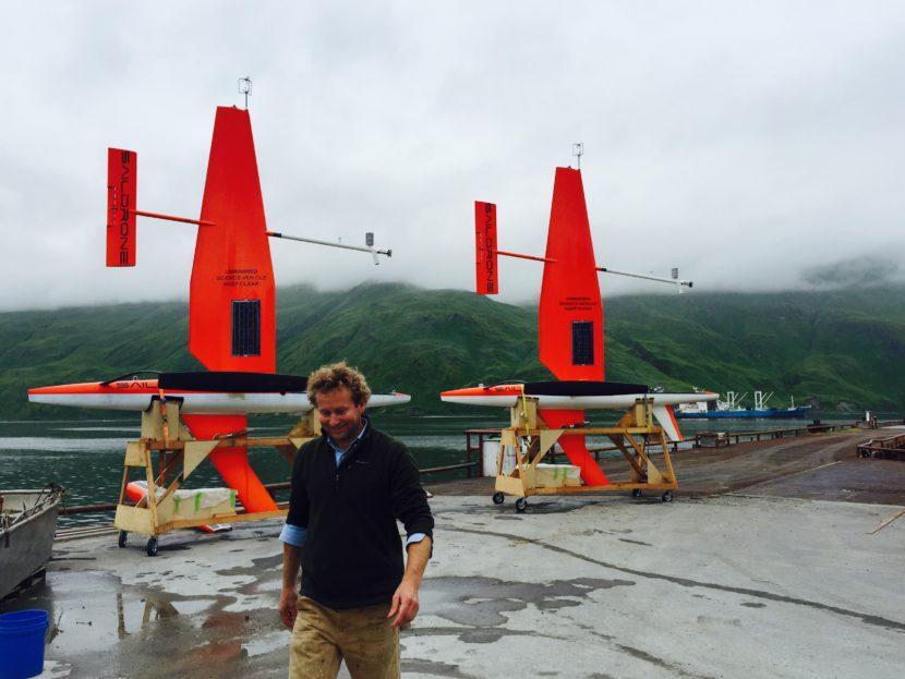 Saildrones Inc. CEO Richard Jenkins turns his back (unwisely?) on two of his creations in Unalaska. Photo: John Ryan/KUCB.