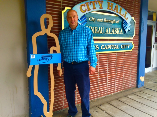 City and Borough of Juneau Chief Housing Officer Scott Ciambor stands with the figurine that was sent from Charleston, South Carolina. (Photo by Scott Burton/KTOO)
