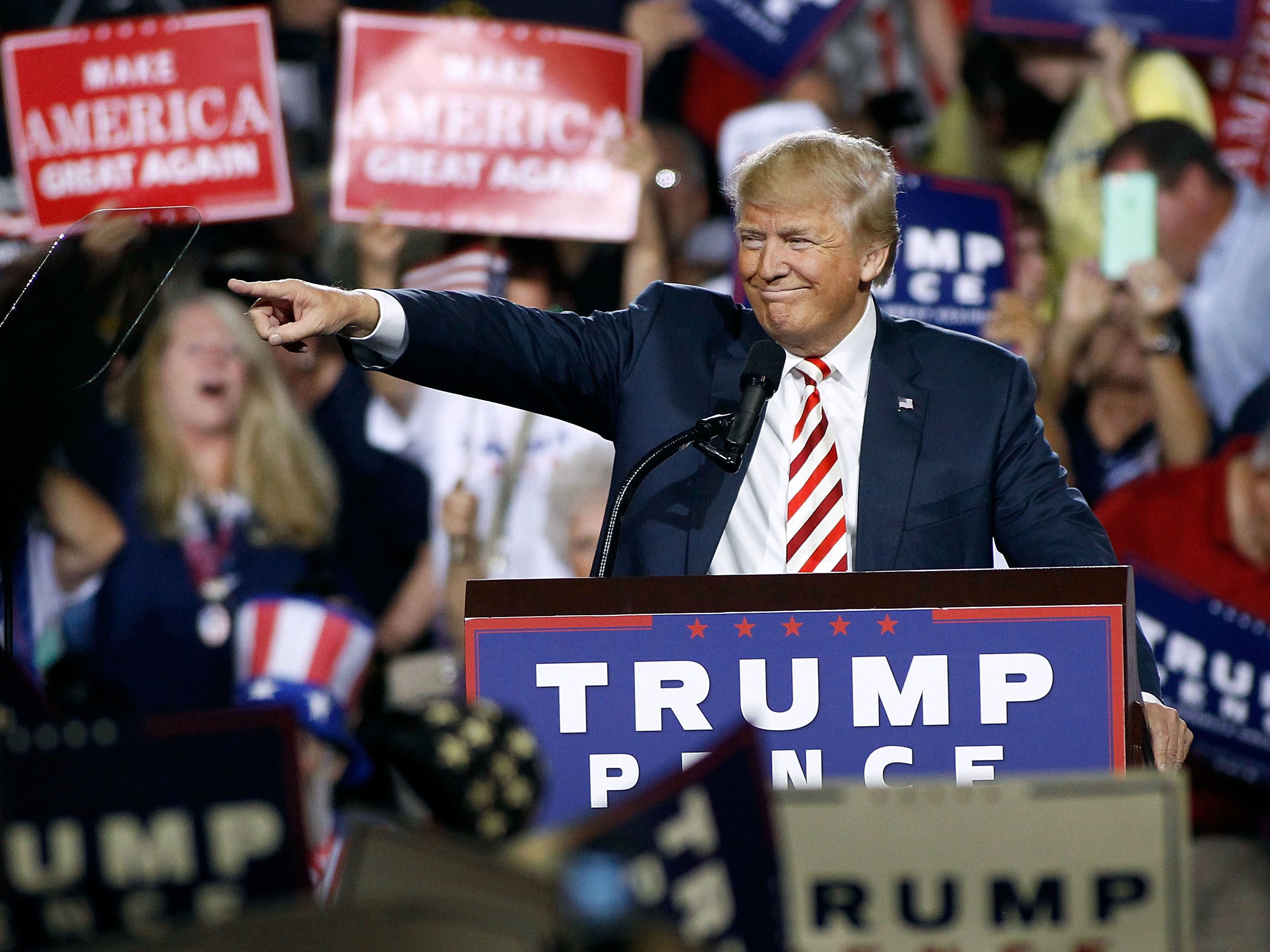 Republican presidential nominee Donald Trump points out to the crowd of supporters as he arrives at a campaign rally on Oct. 4, 2016 in Prescott Valley, Arizona. Ralph Freso/Getty Images