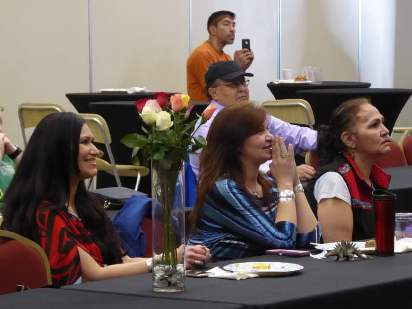 Yolanda Fulmer, left, and other fans watch the Miss USA pageant in anticipation on Sunday. Tommy Gamble pictured in back. (Photo by Quinton Chandler/KTOO)