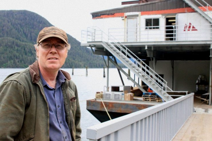 Pat Glaab stands in front of the Northline barge he is converting into a mobile fish processor.