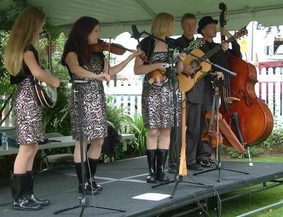 Zashasky Family Alaska String Band perform during celebration on Thursday.