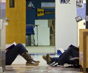 Students study in the hallway at Yaakoosge Daakahidi Alternative High School. (Photo by Heather Bryant)