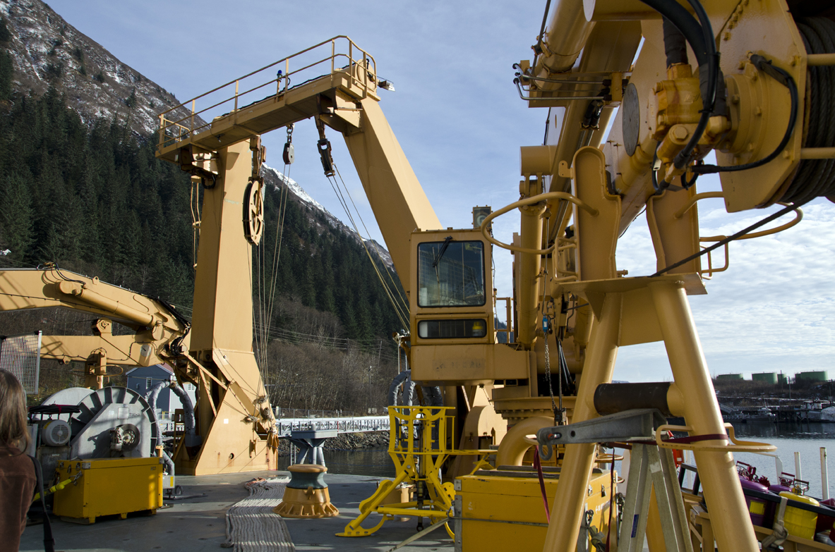 Scientists use the ship's cranes for a variety of things, including scraping the sea floor.