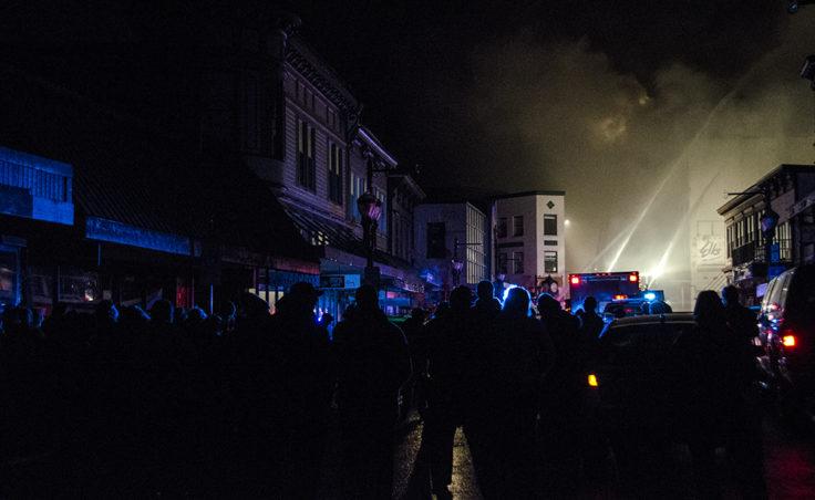 Crowds gather on Franklin Street to watch the blaze.