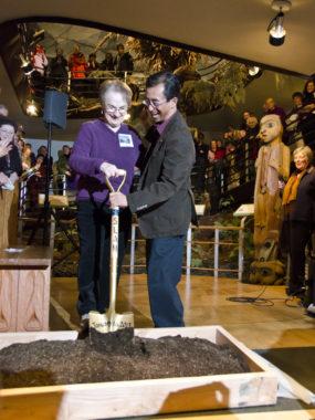 Phyllis DeMuth, member of the 1967 Alaska State Museum Committee, and Ron Inouye, representative of the Alaska Historical Society break ground.