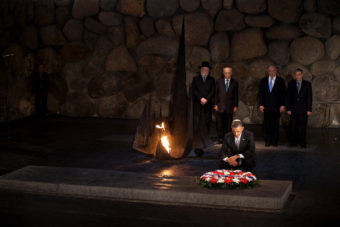 President Barack Obama pays his respects in the Hall of Remembrance in front of Israel's President Shimon Peres, Israel's Prime Minster Benjamin Netanyahu, Chairman of the Yad Vashem Directorate Avner Shalev and Rabbi Yisrael Meir Lau after marines layed a wreath on his behalf during his visit to the memorial on Friday. Uriel Sinai/Getty Images