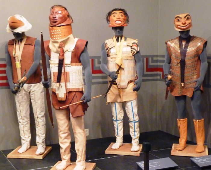 """Four armed, armored figures display Tlingit war gear created by Sitka's Tommy Joseph as part of the Alaska State Museum's """"Rainforest Warriors"""" exhibit. It's one of three Alaska shows tourists will see this season."""