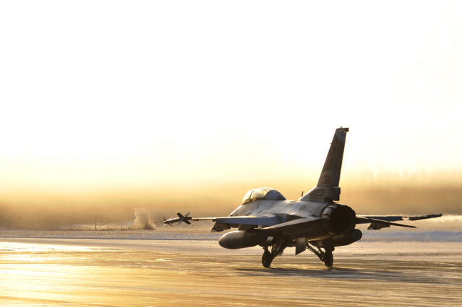 A U.S. Air Force F-16 Fighting Falcon taxis towards the flightline Oct. 27, 2011, Eielson Air Force Base, Alaska. The aircraft is assigned to the 18th Aggressor Squadron. (U.S. Air Force photo by Staff Sgt. Christopher Boitz/Released)