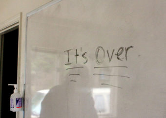 It's over is written on a white board inside the house where clients lived during their stay at the residential treatment program.