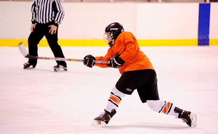 Jill Weitz unleashes a shot during a weekend game in the 10th Annual Jamboree women's hockey tournament at Treadwell Ice Arena. Weitz scored twice in this game.
