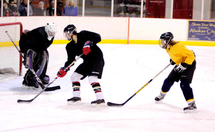 Lorna Wilson (black) keep Emily Ferry from getting off a clean shot during the 10th Annual Jamboree women's hockey tournament at Treadwell Ice Arena.