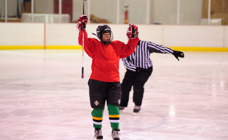 Ingrid Harrald celebrates her team's goal as she skates back to the bench during the 10th Annual Jamboree women's hockey tournament at Treadwell Ice Arena.