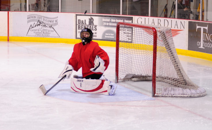Goalie Heather Strickland keeps an eye on puck deflected upward during the 10th Annual Jamboree women's hockey tournament at Treadwell Ice Arena.