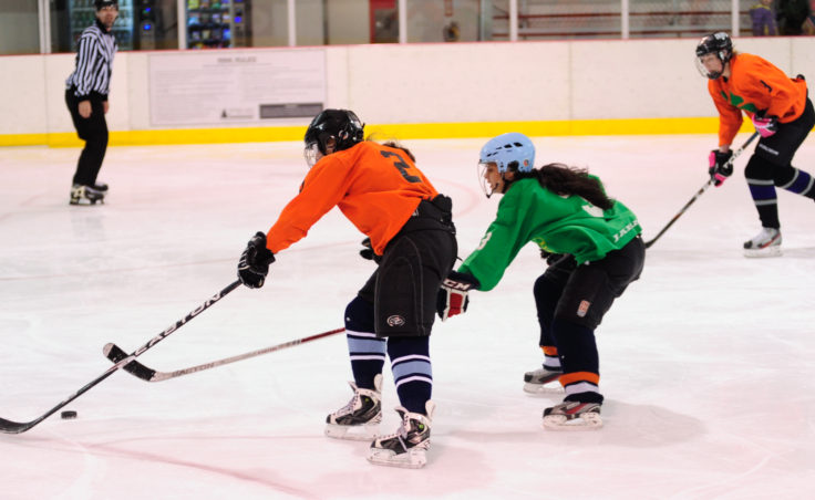 Shamrocks' center Becca Parks (left) tries to stay a step ahead of Yukon Pass defender Christy Hartman during the Tier W title game.