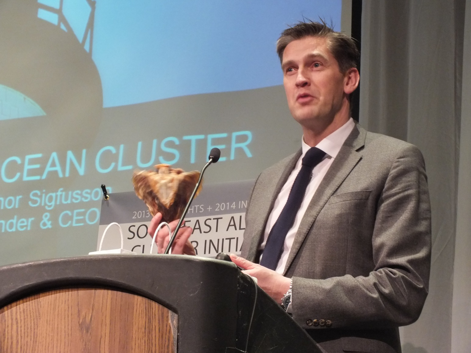 """In 2011, Thor Sigfusson (shown here holding a dried cod head) founded the Iceland Oceans Cluster, which he calls the """"greatest dating service"""" for businesses in Iceland's fishing industry. Photo by Casey Kelly/KTOO."""