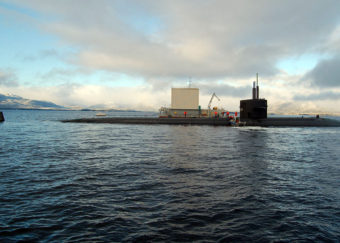 """Fast attack submarine USS Los Angeles (SSN 688) is moored at the Southeast Alaska Acoustic Measurement Facility Static Site in Ketchikan, Alaska, as part of Escape Exercise 2006. """"First and Finest,"""" Los Angeles was the first nuclear-powered U.S. submarine to conduct an open ocean escape. U.S. Navy photo by Mass Communication Specialist 1st Class Cynthia Clark"""