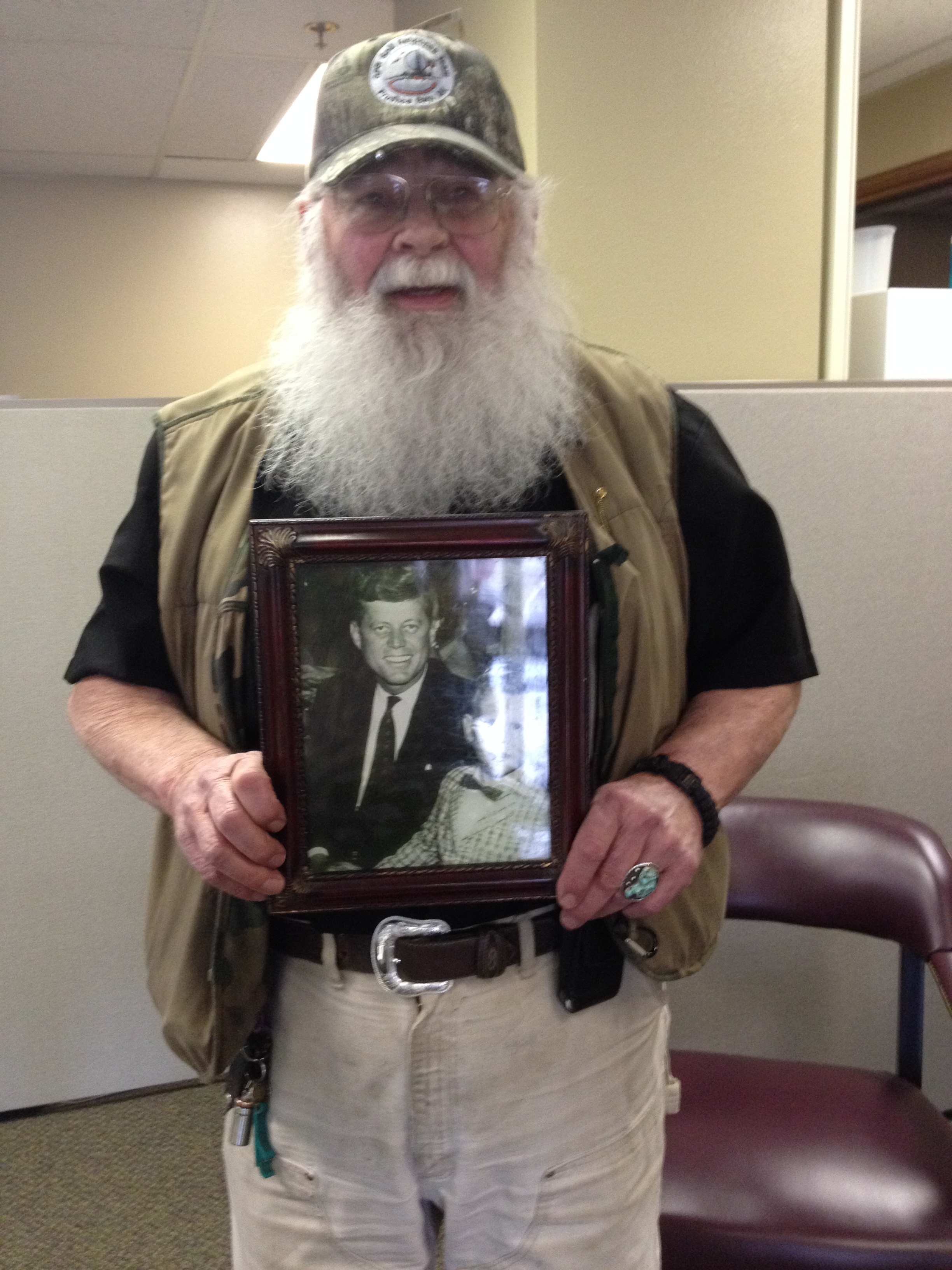 Terry VanLeuven holding his copy of the Kennedy photograph. (Photo by Mary Tarr)