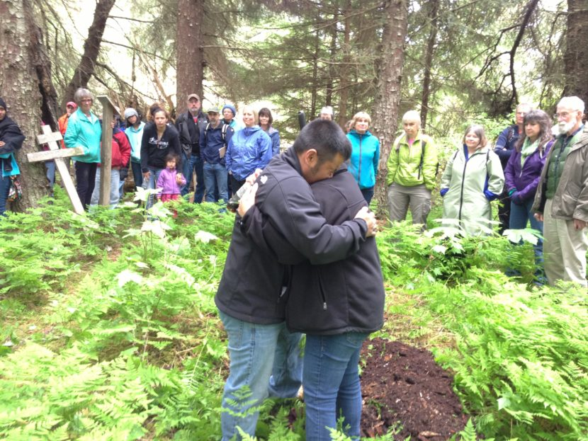 Martin Stepetin and wife Ann embrace when Martin breaks down in tears. Originally from St. Paul, Stepetin has family members who were interned in Funter Bay, 50 miles north of Killisnoo.