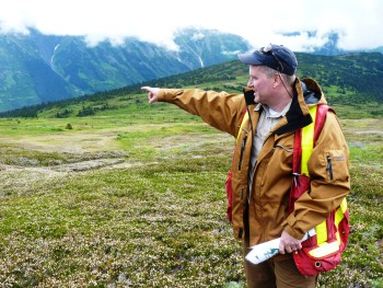 Seabridge Gold's Brent Murphy points to a valley that will be dammed to hold treated mine tailings from the KSM Mine. (Ed Schoenfeld/CoastAlaska)