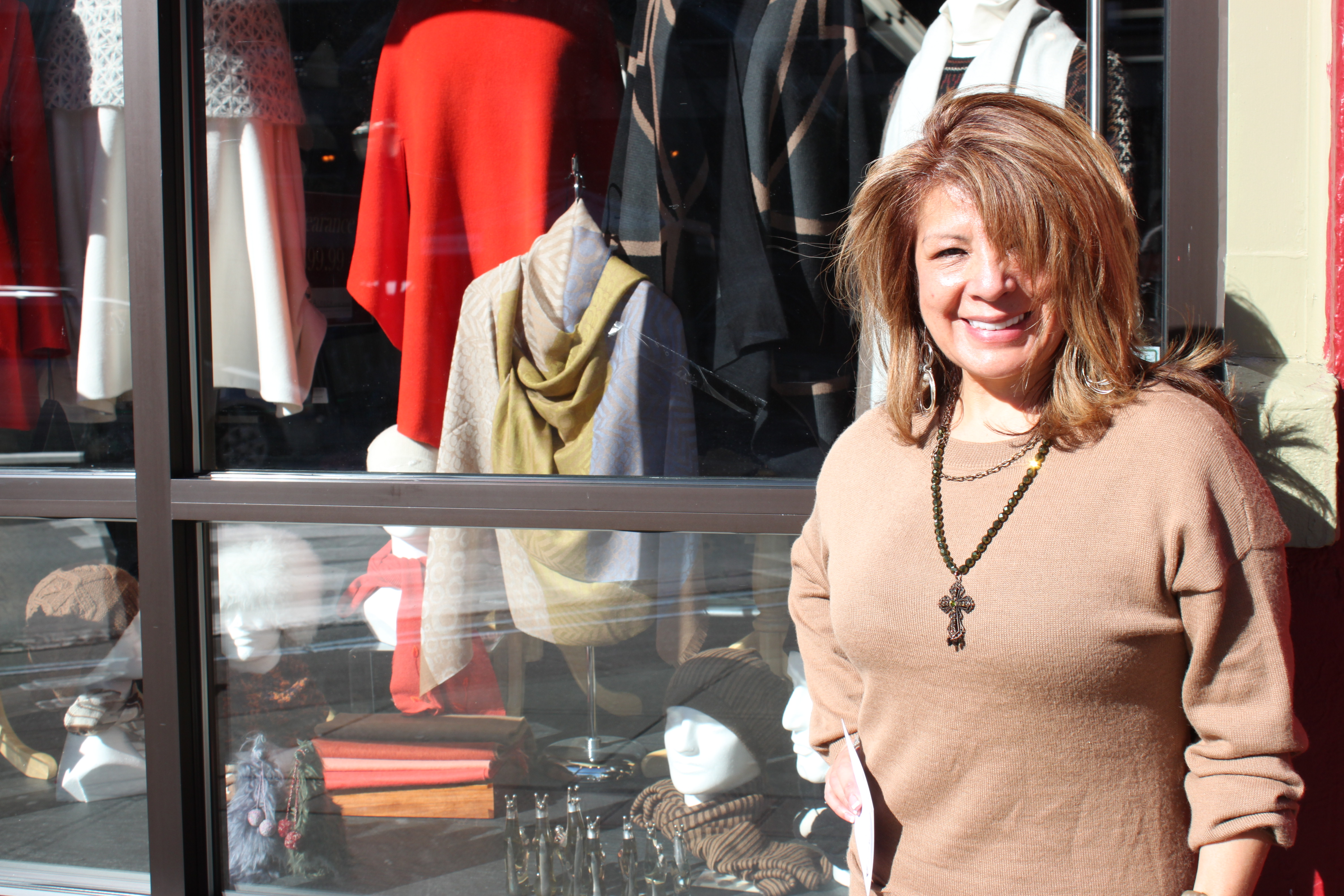 """Alpaca International owner Zia Boccaccio says, unlike previous winters, she'll keep her store window display """"nice, bright and lively."""" (Photo by Lisa Phu/KTOO)"""