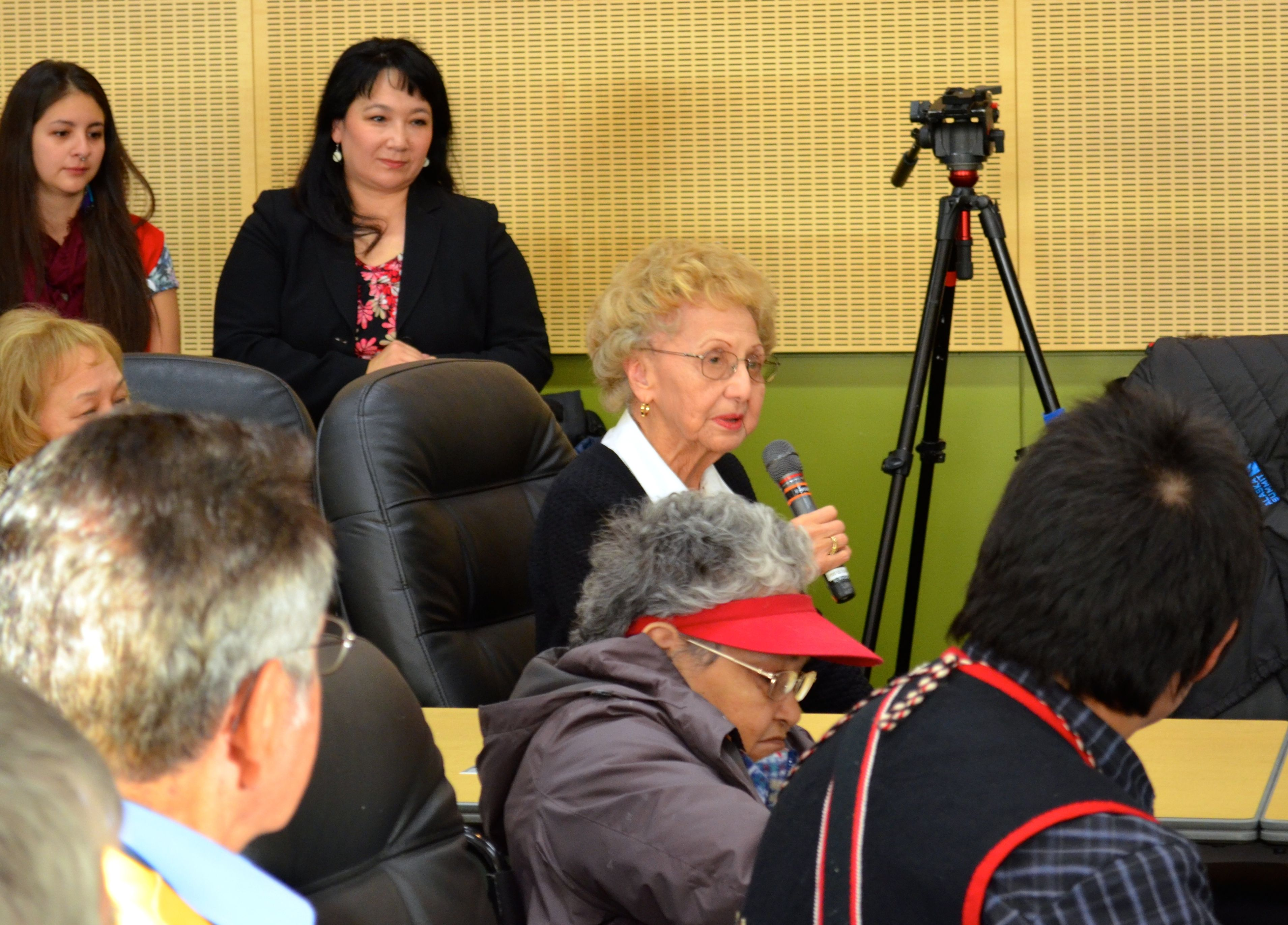 Tlingit elder Kaséix̱ Selina Everson speaks after Gov. Sean Parnell signed a bill making Alaska's Native languages official languages of the state of Alaska. Former Tlingit Haida Central Council President Ed Thomas and Lance Twitchell look on in the foreground. (Photo by Jennifer Canfield/KTOO)