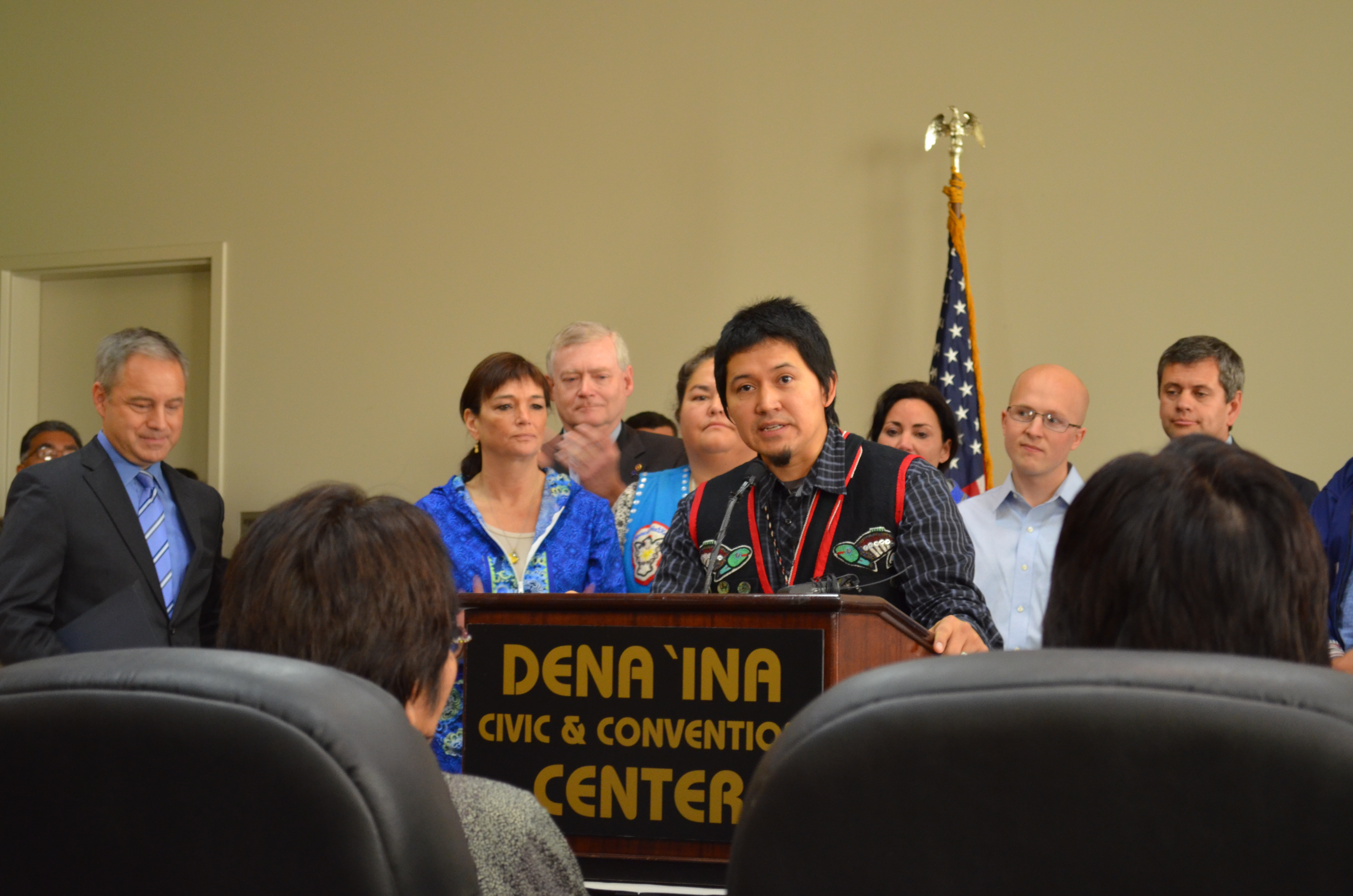 Xh'unei Lance Twitchell addresses the crowd that had gathered for the signing of HB 216, a bill making Alaska's Native languages official state languages. (Photo by Jennifer Canfield/KTOO)