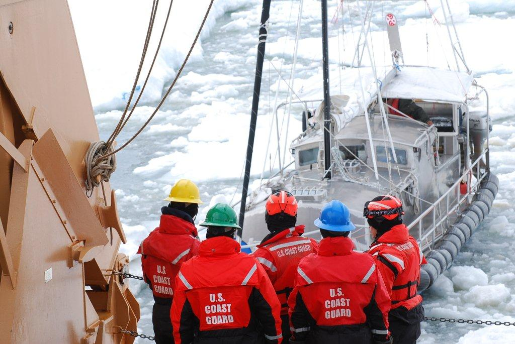 41' sailing vessel Altan Girl is towed out of the sea ice by USCGC Healy after getting stuck about 40 miles northeast of Barrow in July 2014. (Photo by Ensign Carolyn Mahoney, U.S. Coast Guard)