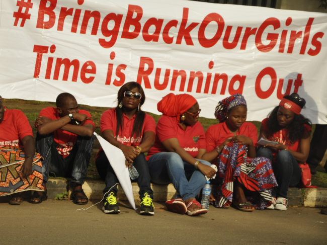 """Members of the Abuja """"Bring Back Our Girls"""" protest group sit during a march in continuation of the Global October movement. Once again, Boko Haram militants are implicated in killings and mass kidnapping in northeastern Nigeria. Afolabi Sotunde/Reuters/Landov"""