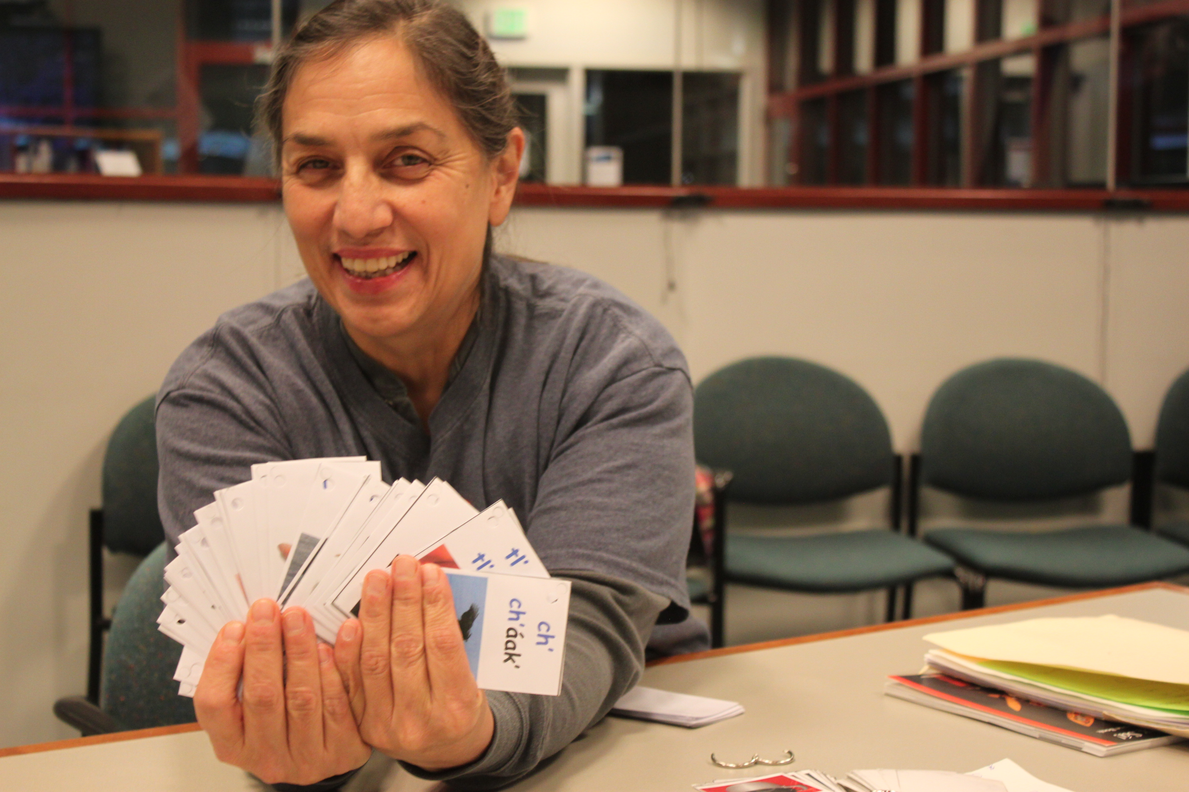 Nancy Keen holds out Tlingit flash cards. (Photo by Lisa Phu/KTOO)