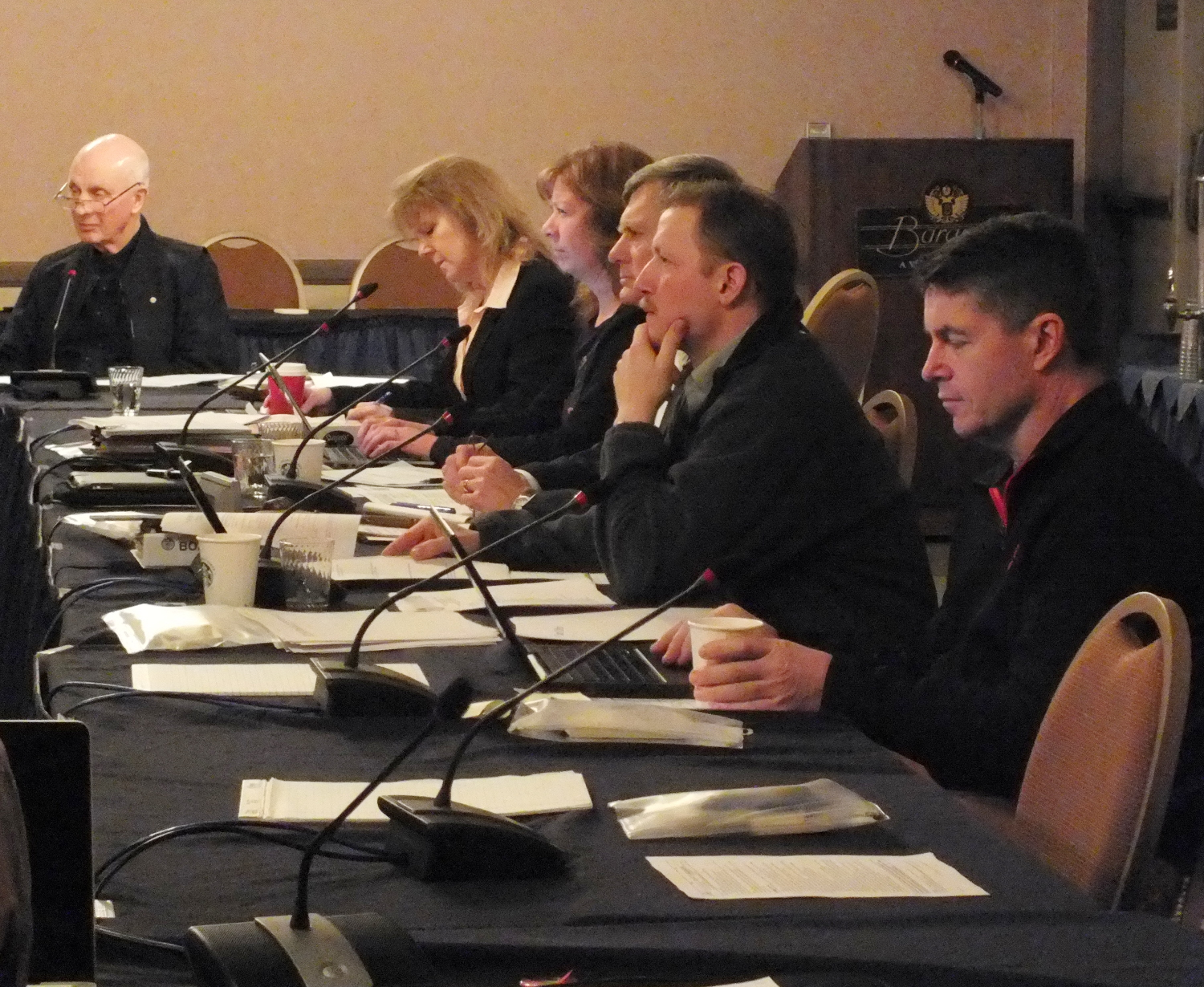 Staff and members of the Board of Game listen to ADF&G acting Commissioner Sam Cotten in Juneau on Jan. 15, 2015. (Photo by Matt Miller/KTOO)