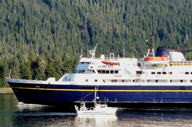 A Petersburg fishing boat passes the ferry Taku near the entrance of Wrangell Narrows in August, 2013. (Ed Schoenfeld/CoastAlaska News)