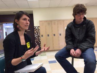Regan Brooks teaches about storytelling as Service High student Kevin Goodman listens. (Photo by Anne Hillman/KSKA)