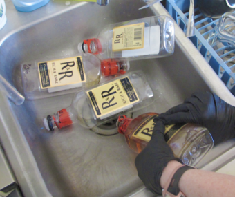 Empty alcohol bottles in a sink