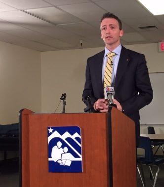 Superintendent Ed Graff speaking at a podium