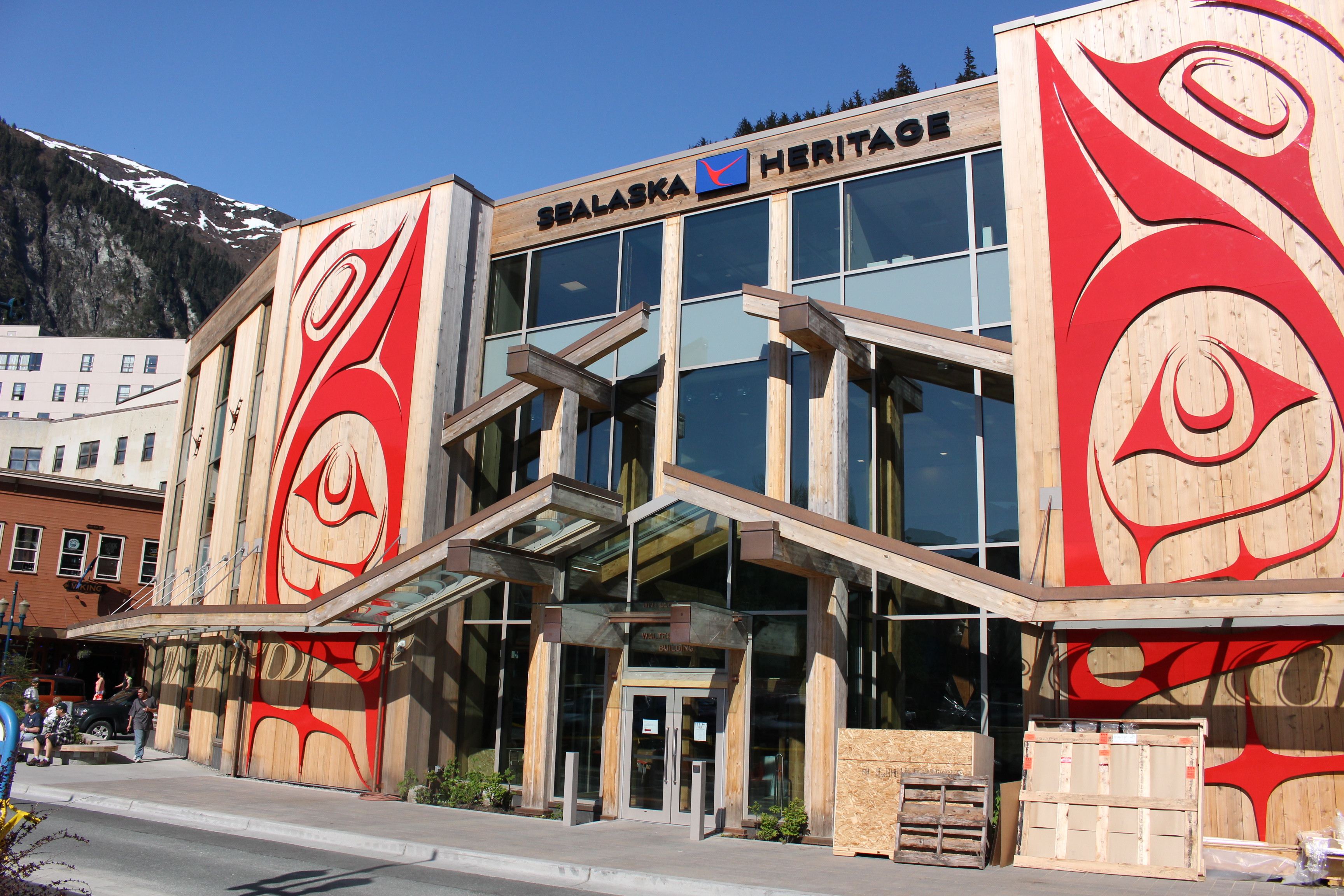 "Haida artist Robert Davidson's metal panel ""Greatest Echo"" adorns the front of the Walter Soboleff Building. (Photo by Elizabeth Jenkins/KTOO)"