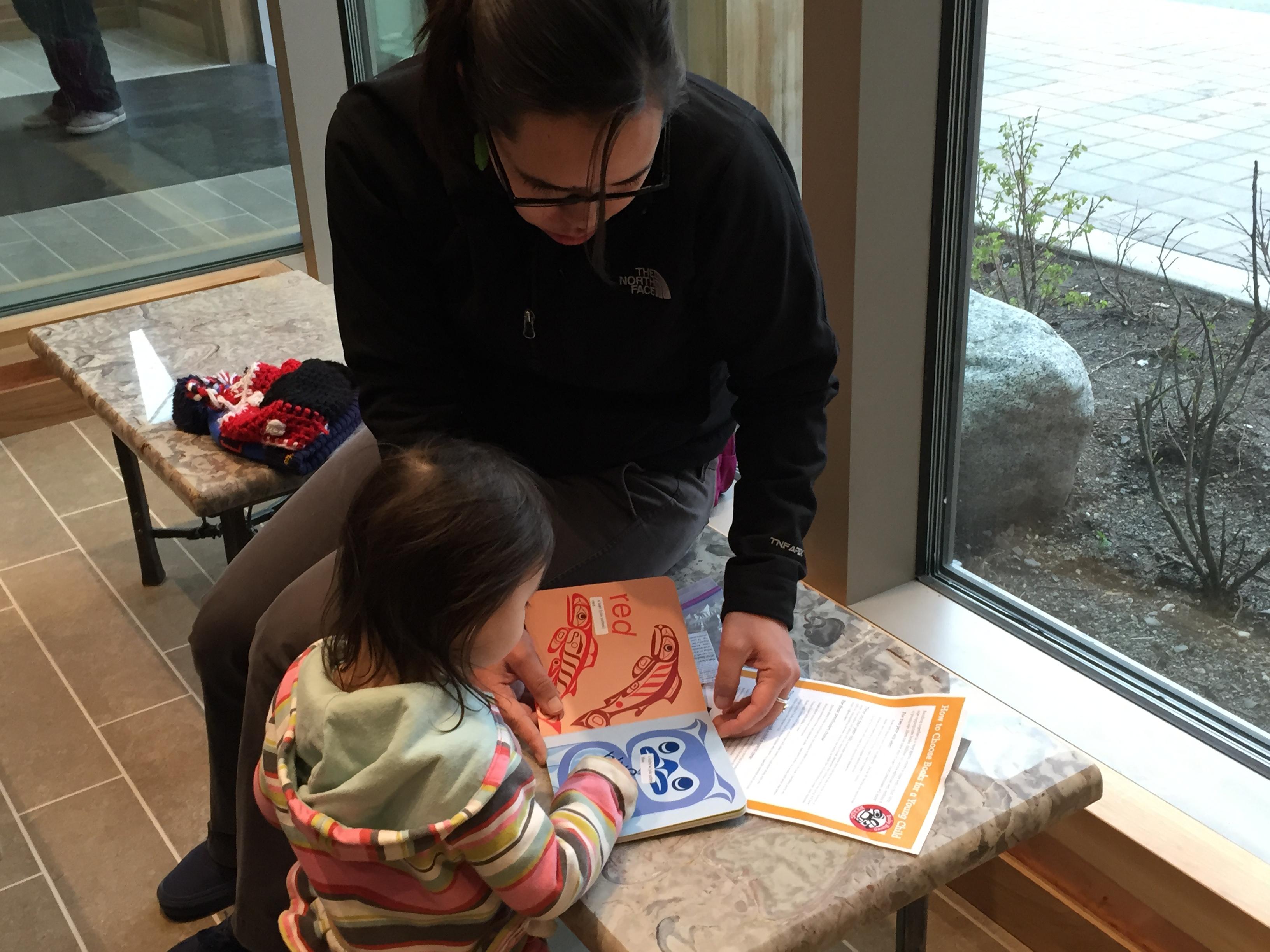Margaret Katzeek brought her niece Elayna Katzeek to the Baby Raven Reads family night. (Photo by Lisa Phu/KTOO)