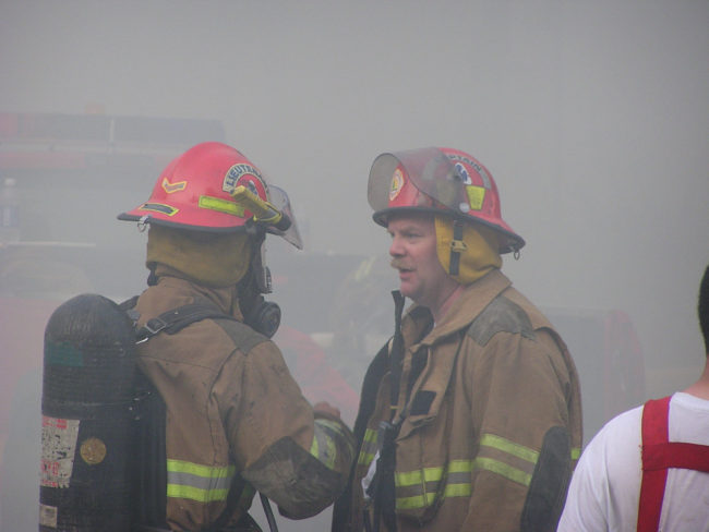 Smoke cuts visibility in downtown Juneau as the historic Skinner Building burns, Aug. 15, 2004.  (Creative Commons photo by Gillfoto)