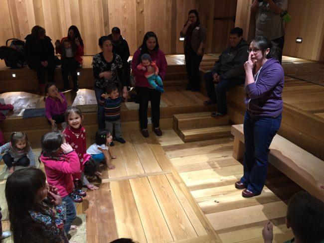 Inside the clan house at the Walter Soboleff Building, Mary Folletti sings familiar sounding songs with Tlingit lyrics. (Photo by Lisa Phu/KTOO)