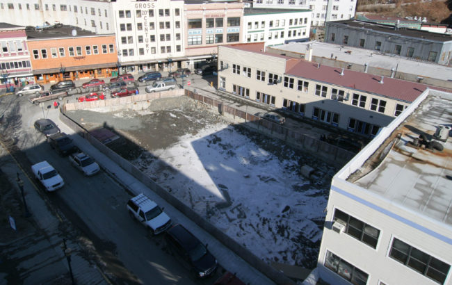 """By the end of 2004, the debris from the Skinner Building fire had been cleared to below street level, creating """"the pit."""" (Photo by Brian Wallace)"""
