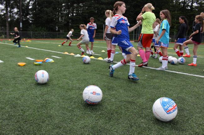 Coach Paris runs the girls through drills. (Photo by Elizabeth Jenkins/KTOO)