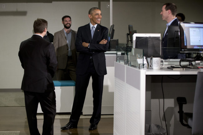 President Obama tours the Louisville-based tech company Indatus with Indatus president Philip Hawkins (left). Carolyn Kaster/AP