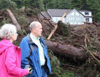 Gov. Bill Walker (right) and Sitka Mayor Mim McConnell visited the site of the Kramer Avenue landslide on Wednesday, Aug.19. (Photo by Rachel Waldholz/KCAW)